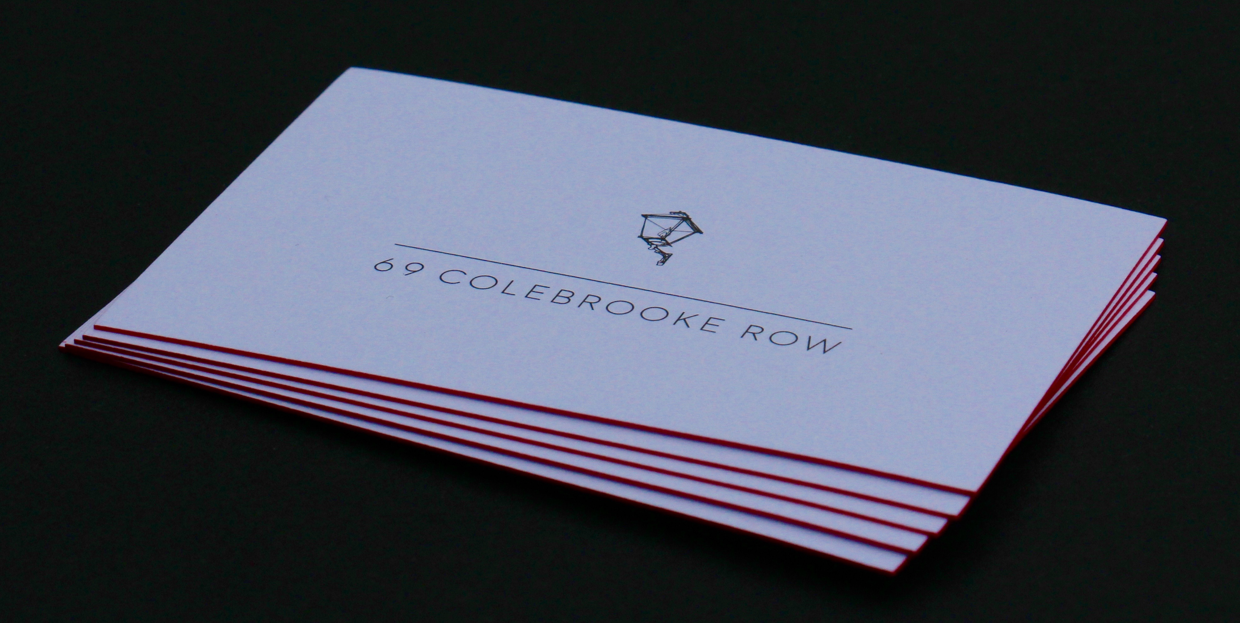 Foil blocked logo in black on a white 330gsm board with red edge paint