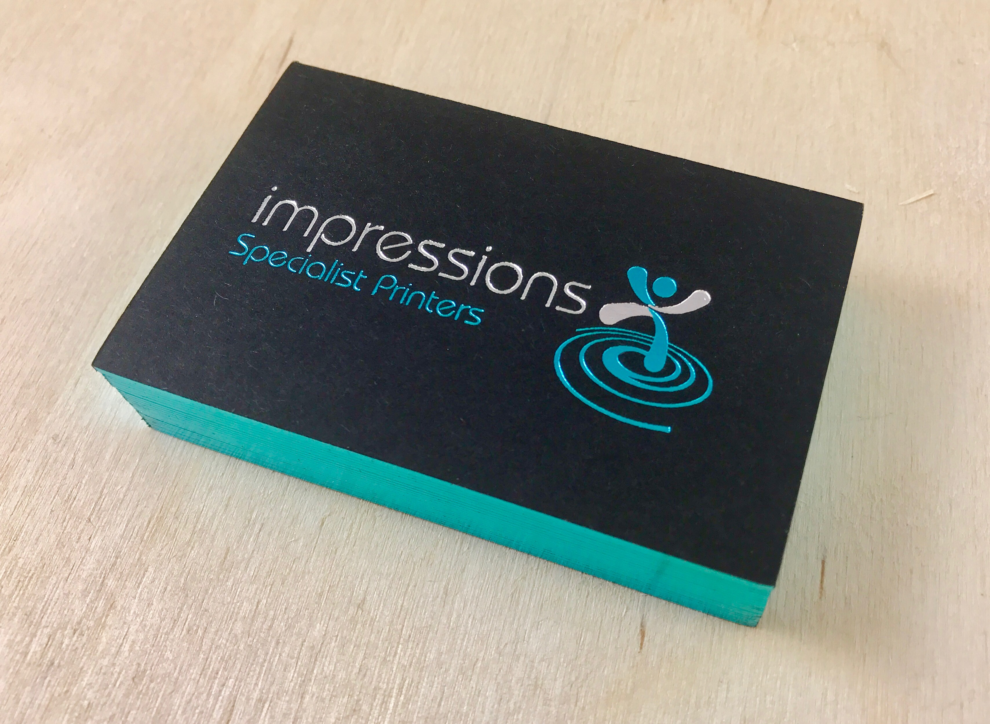 Impressions Business Cards, Foil Blocked in Blue and Silver with Foil Edge