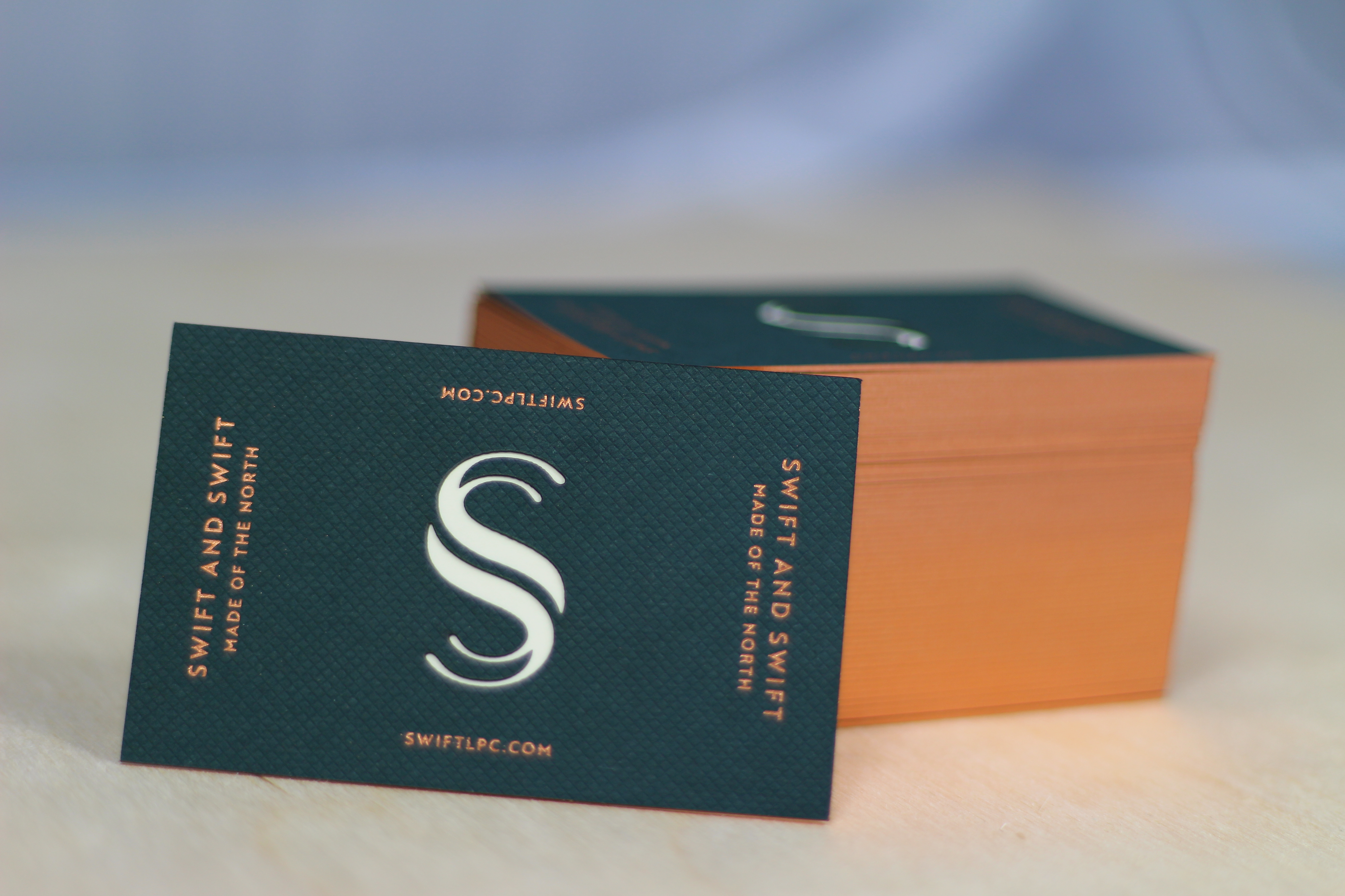 Business Cards, Foiled in Copper with Laser Cut Logo to Show Reverse Stock