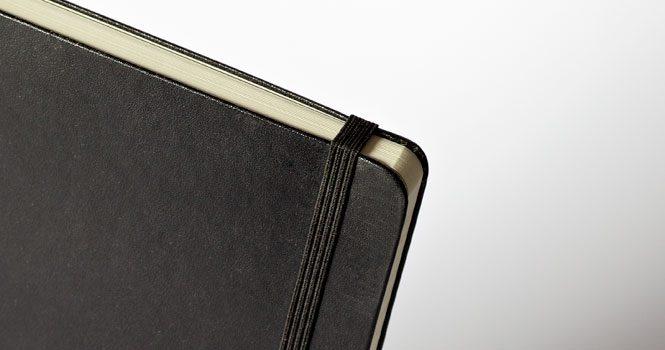 Foil Blocked in black on a white Moleskine book