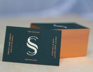 Business Cards, Foil blocked in Copper, with laser cut logo to show reverse colour